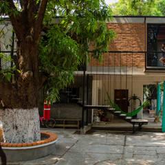 Casas ecológicas de estilo  por Taller del patio, Industrial Ladrillos