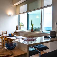 Dining room by Studio ARCH+D, Mediterranean