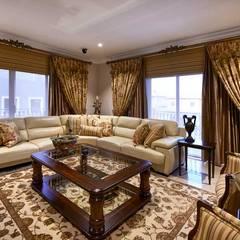 European Influence Villa:  Living room by Da Rocha Interiors, Mediterranean