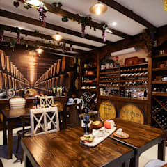 European Influence Villa:  Wine cellar by Da Rocha Interiors,