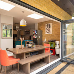 Rear Extension - Connecting Kitchen, Dining and Patio with Bi-fold door:  Dining room by scaleruler, Modern