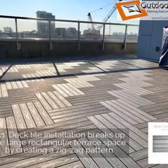 Silver Grey Wood-Plastic Composite Deck Tiles Installed on Toronto Terrace Modern terrace by Outdoor Floors Toronto Modern
