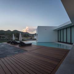 CASA PEDREGAL 1: Casas ecológicas de estilo  por M TALLER DE ARQUITECTURA, Moderno Concreto