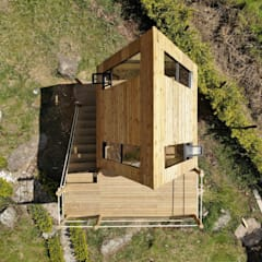 Wooden houses by TALLER DOS ARQUITECTOS,