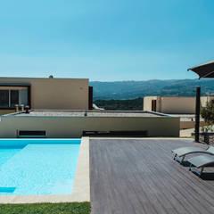 Jardim de Habitação Unifamiliar: Jardins  por Hugo Guimarães Arquitetura Paisagista,Minimalista
