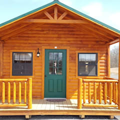 Log cabin by Chalets & Lofts, Rustic Solid Wood Multicolored