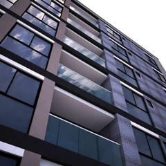Edificio Vivienda multifamiliar: Casas multifamiliares de estilo  por Velasco Arquitectura, Moderno