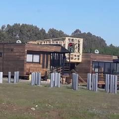 ampliacion rancho pinares, punta de lobos, pichilemu , chile: Cabañas de estilo  por Q-bo proyectos de construccion, Moderno Madera Acabado en madera