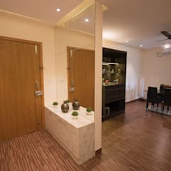 Luxury 3 BHK Interiors at Mantri Serene in Chennai:  Corridor & hallway by Aikaa Designs,Modern