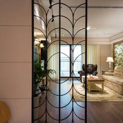 Pasillos y recibidores de estilo  por 松泰室內裝修設計工程有限公司 , Rural Metal