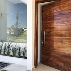 Modern style doors by Planlife Edificaciones Modern