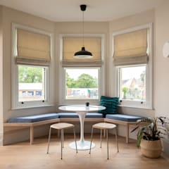 The Christmas House Scandinavian style dining room by Fraher and Findlay Scandinavian