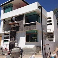 Дома на одну семью в . Автор – Arqcubo Arquitectos, Минимализм Бетон