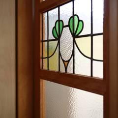 あそびごころの家 戸建リノベーション: 池田デザイン室(一級建築士事務所)が手掛けたドアです。,オリジナル