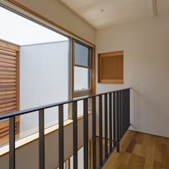 壁の向こうの棲家: FOMES designが手掛けた廊下 & 玄関です。,オリジナル