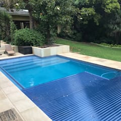 Automatic Pool Covers:  Garden Pool by Pool Cover Pro, Modern