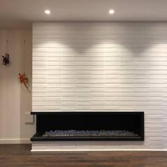 Apartamento AGS: Paredes de estilo  por entrearquitectosestudio, Moderno Ladrillos