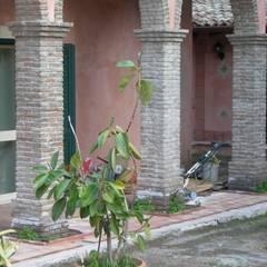 منزل عائلي صغير تنفيذ ELLEQUADRO PROGETTI- Architetti Elisa Lanza e Rino Leonardi , ريفي
