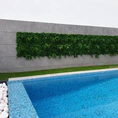 Jardim de sonho _ moradia: Piscinas  por MEA Interior Design,Tropical
