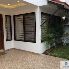 Front garden by URBTEC ENGINEERING CONSTRUCTION PVT LTD, Modern