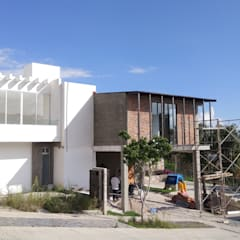Casas ecológicas de estilo  por Itech Kali, Industrial Ladrillos