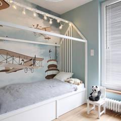 Dormitorios de bebé de estilo  por MIKOŁAJSKAstudio , Moderno