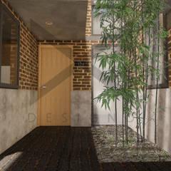 Многоквартирные дома в . Автор – Designo Arquitectos, Рустикальный Кирпичи