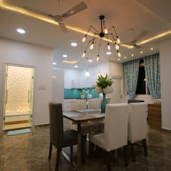 Elegant Styled Vibrant 3BHK Project @ Alwal Modern dining room by Enrich Interiors & Decors Modern