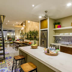 Small kitchens by UNO DOS INTERIORES, Eclectic