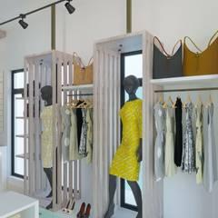 BOUTIQUE: Oficinas y Tiendas de estilo  por DUALEC 'Diseño y Construccion',Moderno Aglomerado
