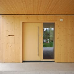 Wooden doors by schroetter-lenzi Architekten, Modern Wood Wood effect