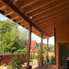 Terrazas de estilo  por THULE Blockhaus GmbH - Ihr Fertigbausatz für ein Holzhaus, Escandinavo