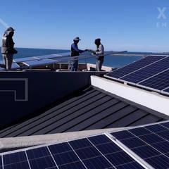 Techos de estilo  por XUSOL Energía Solar, Industrial