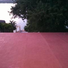 Telhados de meia água  por Grecia Instalaciones y Servicios , Clássico