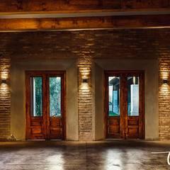 Salones de eventos de estilo clásico de JAO ARQUITECTOS Clásico Ladrillos