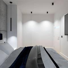 Sypialnia beton i granat od Wkwadrat Architekt Wnętrz Toruń Nowoczesny Płyta MDF