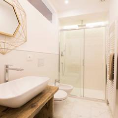 Mediterranean style bathrooms by GruppoTre Architetti Mediterranean