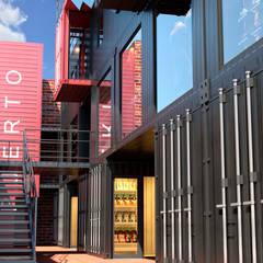 Shopping Centers industriais por Mansarda Estudio Industrial Metal