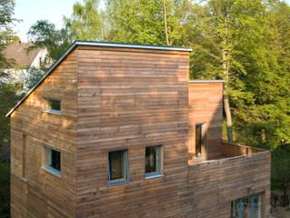 Architekturbüro Riek Rustic style houses
