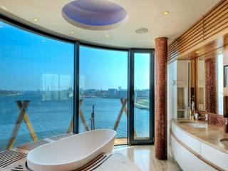 Penthouse im Stadthafen: moderne Badezimmer von  baustudio kastl
