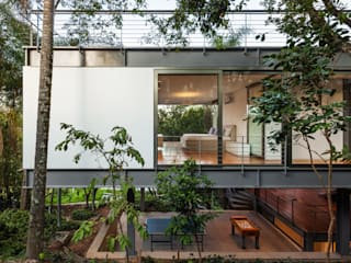Casas de estilo  por obra arquitetos ltda