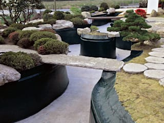 Asian style garden by Kirchner Garten & Teich GmbH Asian
