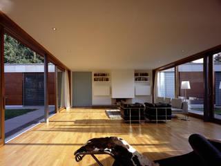 Living room by Architektur & Interior Design