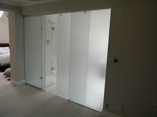 Frosted Glass Sliding Door partition in Cambridge:  Sliding doors by Go Glass Ltd