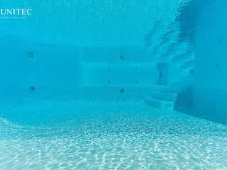 Jardines de estilo  por Gunitec Concept Pools