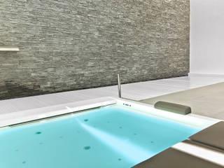 Piscina interior cubierta con spa Piscinas de Gunitec Concept Pools