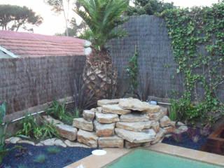Valldoreix-Cascada Jardines de estilo mediterráneo de Naturalgreen Jardiners Mediterráneo