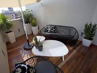 Terrasse de style  par Laura Yerpes Estudio de Interiorismo
