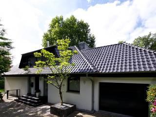 Casas de estilo  de GRID architektur + design, Moderno