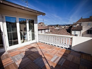 Balcones y terrazas eclécticos de Arcostudios Ecléctico